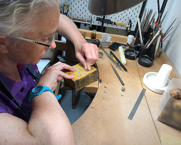 De Burca Design making Mary engraving silver leaves at workbench
